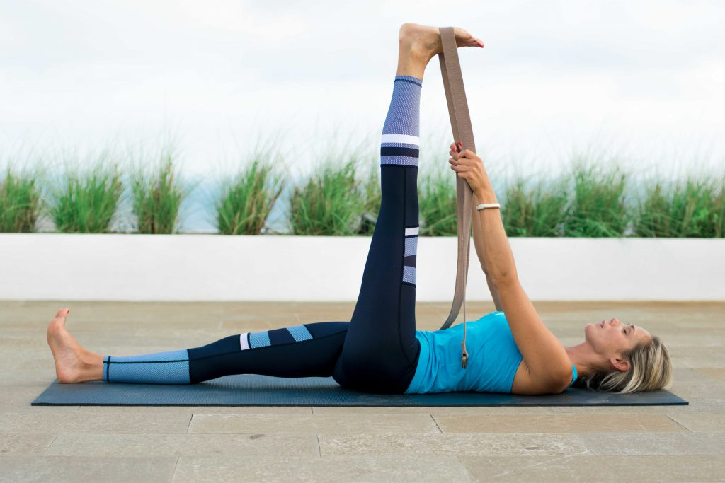 Reclining Hand-To-Big-Toe pose with a strap releases tight hamstrings.
